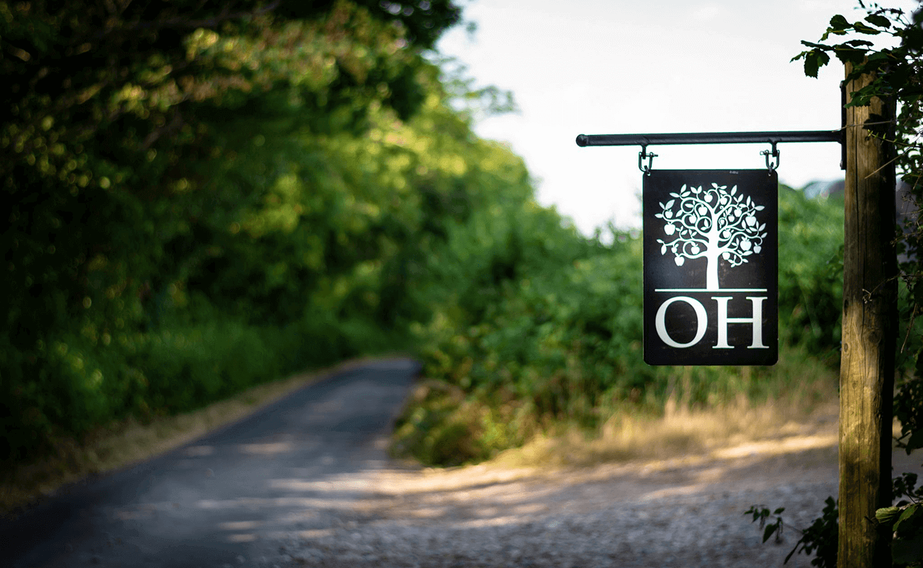 Orchard House Partners Logo on road